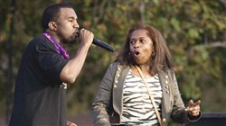 "Singer Kanye West performs with his mother, Donda West, outdoors during a taping of ""The Ellen DeGeneres Show,"" in May, 2006 in Burbank, Calif."