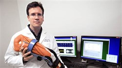 Doug Weber, a biomedical engineer with the University of Pittsburgh Department of Physical Medicine and Rehabilitation, with the knee brace.