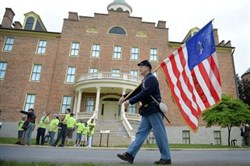 Stan Zellers, of Lewisburg, Pa., marches in front of the Seminary Ridge Museum Monday in Gettysburg. Mr. Zellers said he was re-enacting an 8-mile march his ancestor, John Kline with the 142nd Pennsylvania, marched 150 years ago.