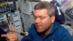 Shuttle commander -- and Richland High School graduate -- Stephen N. Frick enjoys a snack aboard Atlantis.