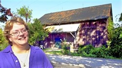Sunny Disney Fitchett, seen in 2001 beside Little Lake Theatre's original setting, is retiring after 22 years as artistic director of the theater, which was founded by her father, Will Disney.