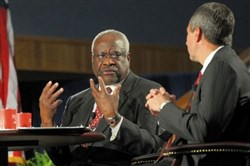 U.S. Supreme Court Justice Clarence Thomas speaks to appellate court Judge Thomas M. Hardiman on Tuesday at Duquesne University.