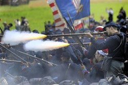 Gettysburg 150thUnion re-enactors fire their guns at approaching Confederate soldiers during a presentation of Pickett's Charge on Sunday at Bushey Farm in Gettysburg.