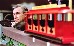 "Fred Rogers pauses during a taping of his show "" Mister Rogers' Neighborhood."""