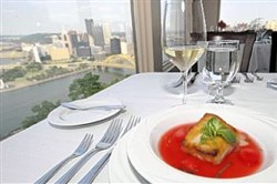 The view from Isabela on Grandview, atop Mount Washington, with a serving of honey-glazed blue marlin with fresh watermelon, pickled watermelon rind and a mint gastrique