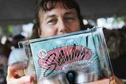 Dee Stahl shows off the Slinky she bought for $40 at the estate auction of the late Betty James, co-founder of the firm that made the famous Slinky toy.