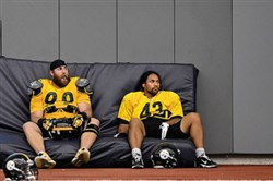Steelers greats Troy Polamalu and Brett Keisel, shown here during their playing days taking a break during workouts at the team's South Side facility, are among the veterans with two Super Bowl rings to leave the team.