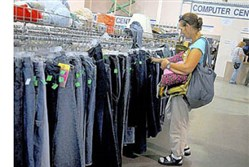 A Lawrenceville resident looks for bargains inside the Goodwill Lawrenceville store.