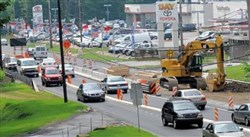 Traffic snakes through a construction zone on Route 51 in Pleasant Hills. A Connecticut construction company was ordered Monday to pay $15.8 million in damages to the family of a Finleyville woman injured in a Route 51 crash five years ago.