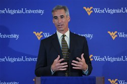 Oliver Luck has been athletic director at West Virginia University since 2010 and was a member of the inaugural College Football Playoff committee.