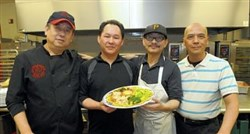 Mike Chen of Everyday Noodles in Squirrel Hill and other restaurants, stands with Steve Chow, Binh Li and Shyi Long Tseng, members of the Chinese Restaurant Association.