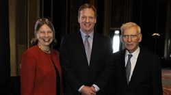 Dr. Tori Haring-Smith standing by NFL Commissioner Roger Goodell and Dan Rooney in an honorary ceremony.