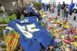 A Chargers No. 55 jersey sits atop a makeshift memorial outside Junior Seau's home.