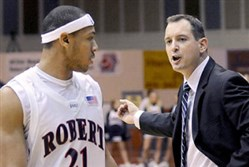 Mike Rice, right, as coach of Robert Morris. Rice, who nearly led the No. 15-seed Colonials to an upset of No. 2-seed Villanova in the 2010 NCAA Tournament, said he would be open to a return to coaching college basketball in the future.