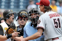 The Pirates' Doug Mientkiewicz  and Diamondbacks pitcher Randy Johnson argue during a 2008 game. Johnson was elected to the baseball Hall of Fame today.