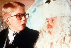 "Peter Billingsley as Ralphie and Jeff Gillen as Santa Claus in the movie ""A Christmas Story."""