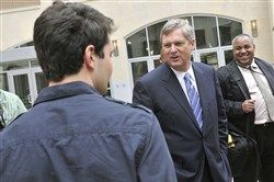 U.S. Agriculture Secretary Tom Vilsack, center, talks with students from Point Park University in 2011.