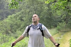 Paul Kirsch, of Gibsonia, reaches the finish line of the 2013 Rachel Carson Challenge, a 34-mile hike.