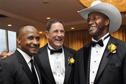 Ex-Steeler and Robert Morris head football coach John Banaszak, center, with his former teammates Lynn Swann  and Mel Blount.