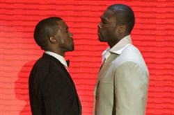 50 Cent, right, and Kanye West face off before they present an award at the 2007 MTV Video Music Awards at the Palms Hotel and Casino in Las Vegas.