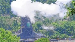 Steam rising from the coke quenching process at U.S. Steel's Clairton Coke operation looms in the distance at the bottom of Clairton's Maple Avenue.