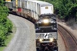 An eastbound Norfolk Southern train pulling container cars rolls through Ardara, Pa.