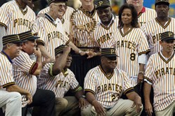 Members of the 1979 world championship Pirates together with the World Series trophy before a game in 2009. From left to right, top row, Omar Moreno, Bruce Kison, partially blocked by Chuck Tanner, Kent Tekulve, Bill Madlock, wife of the late slugger Willie Stargell, Margaret Stargell, Don Robinson, and Rennie Stennett,, Bottom row right to left are Dale Berra , Mike Easler, Grant Jackson, Steve Nicosia and Phil Garner.