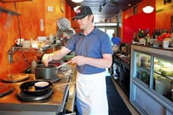 Owner Paul Krawiec works in the kitchen at Cafe du Jour.