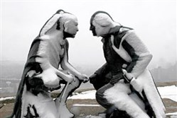 "Snow shrouds ""Points of View,"" a bronze sculpture by James A. West that depicts a meeting between Seneca leader Guyasuta and George Washington. It was installed on Mount Washington in 2006."