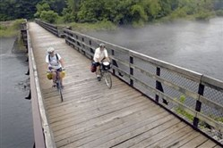 Bikers riding along the Great Allegheny Passage.