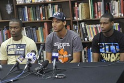 Tyler Boyd, center and his Clairton High School teammates, Terrish Webb, left, and Titus Howard, right, on National Signing Day in 2013 -- all signed letters of intent to play football for the University of Pittsburgh.