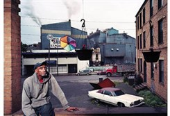 "Mark Neville's ""My neighbor Joe with our view of the Edgar Thomson Steel Mill,"" 2012."