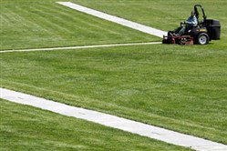 Derrick O'Toole mows the grass at Point State Park, Downtown.