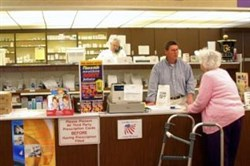 Verna Alexander, 86, talks with Bill Hewitt about her prescription at the Rosemont Pharmacy in Portland, Maine.