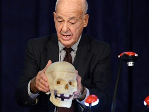 Cyril Wecht, the former Allegheny County coroner and forensic science consultant, uses a skull to discuss the assassination of President John F. Kennedy from a forensic point of view during an International symposium in 2013 at Duquesne University.
