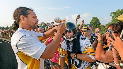 "011.jpg Steelers safety Troy Polamalu signs an autograph for a ""look-alike"" before practice at Saint Vincent College in Latrobe last year."
