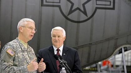 911th Adjutant General of Pennsylvania Wesley Craig, left, talks to the media at the 911th Airlift Wing in Moon on Friday as Gov. Tom Corbett looks on.