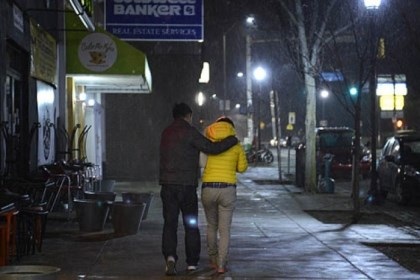 A couple A couple hurries along Forbes Avenue as it begins to snow in Squirrel Hill.