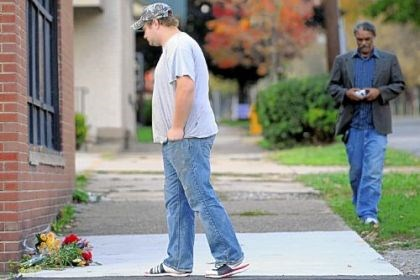 A friend A friend of slain Washington and Jefferson football player Tim McNerney pauses Thursday at the scene of the killing across the street from campus.