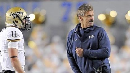 A frustrated Dave Wannstedt A frustrated Dave Wannstedt throws his headset to the turf Friday night after having to call a timeout in the third quarter of the Backyard Brawl in Morgantown, W.Va.