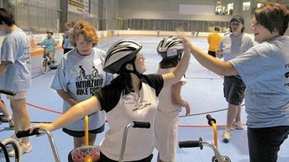 A high five Katelyn Schultz, 15, of Crafton, gets a high five from volunteer Annemarie Bunch, of Pittsburgh, at the Lose Your Training Wheels event at the Iceoplex at Southpointe in Cwcil. She had just finished her first session at the camp. In the background is volunteer Roberta Danner, of Ross, left, Lucy Devlin, 13, of Mt. Lebanon, and Sharon Colantonio, of St. Louis, Mo., who works as floor supervisor for the event.