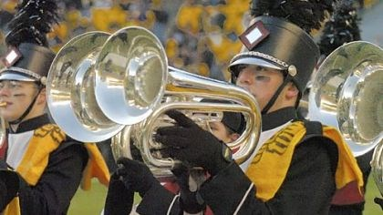 A musical Terrible Towel William Prince, a senior at Elizabeth Forward High School, wears a Terrible Towel on his uniform while performing with the marching band before the Steelers Jets playoff game in January 2005.