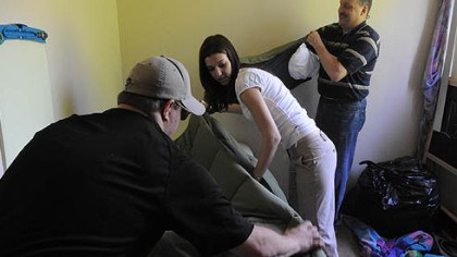 A new mattress Andrew Lambl, a volunteer from Murrysville, arranges some bedding while Andrea Germansky, a first-grade teacher at Pittsburgh Schaeffer K-8 school, reaches for items to place on J'Quinn Johnson's bed in her Crafton Heights home.