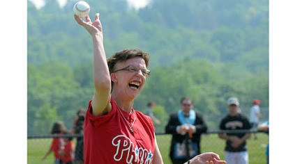 A PERFECT PITCH Genny Kanka throws out the first pitch at the first game Saturday on the newly opened Miracle League Field in Boyce Mayview Park in Upper St. Clair.