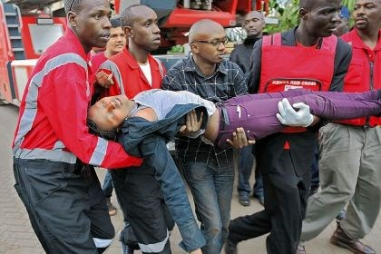 A woman who had been held hostage A woman who had been held hostage and fainted due to shock is carried by rescue personnel Saturday after she was freed following a standoff at the Westgate shopping mall in Nairobi, Kenya.