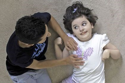 Abby Shuckrow Abby Shuckrow, 9, looks at her brother Zach, 13, while lying on the carpet at their home in McCandless. Abby has had a form of epilepsy known as Lennox-Gastaut syndrome since she was 2 months old.