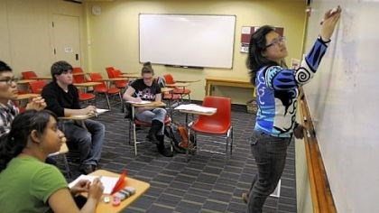 Academic development Carnegie Mellon student Daisy Wang, at board, helps students Jessica Price, left to background, Dae Jun Hyun, William Maher, and Tanushree Chellam in differential equations in an academic development program session.