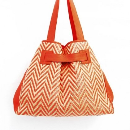 Addison raffia purse Addison raffia orange purse, $398 at www.kooba.com.
