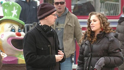 """Adventureland"" Greg Mottola, a CMU graduate, talks to actress Margarita Levieva while filming ""Adventureland"" at Kennywood Park on Thursday."