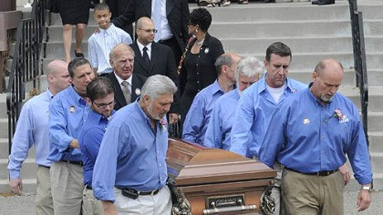 After the service Billy Mays' casket is carried out of St. John of God Catholic Church in McKees Rocks following his funeral Mass.